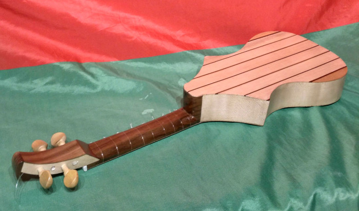 Back and side view of 4 string version with body of European Sycamore and European Walnut, and neck of European Walnut..